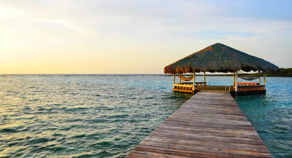 Honduras Roatan Barefoot Cay Pier Palapa