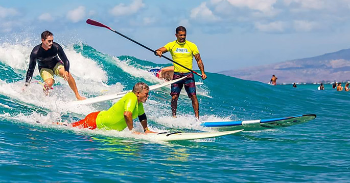 Bill Martin Makuakai Rothman And Kala Alexander Share A Wave At Waikiki Beach During The Annual Duke S Oceanfest Accessurf Adaptive World Surf